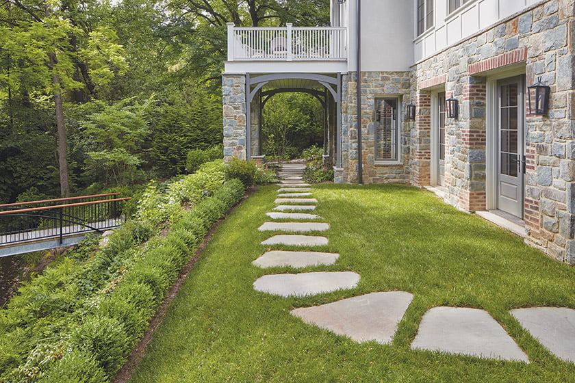 Stone paths and a metal-and-ipe bridge provide avenues for wandering the property. © David Burroughs