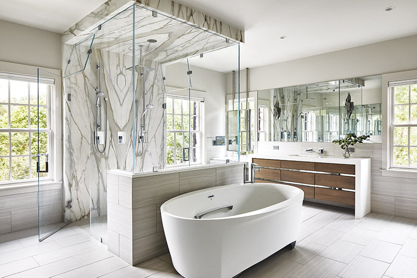 A five-by-six-foot, glass-enclosed shower is the showpiece of the owners' bath.