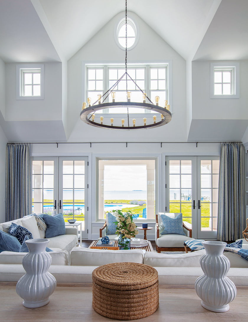 A Ferrell Mittman sectional in the great room takes in the view while a slender Arteriors chandelier draws the eye.