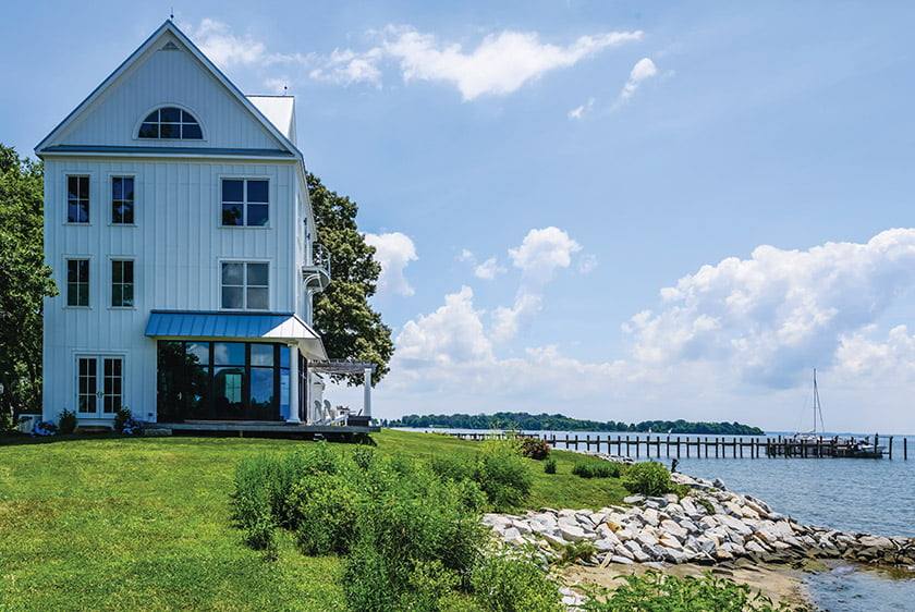 Designed by architect Marta Hansen, a home on Whitehall Bay near Annapolis features a curved wall of floor-to-ceiling windows that take in unobstructed water views. PHOTO: MARTA HANSEN