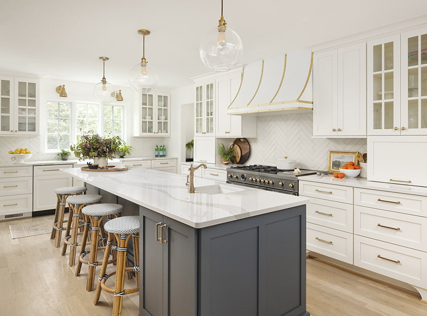 White kitchen with oversized dark-painted island