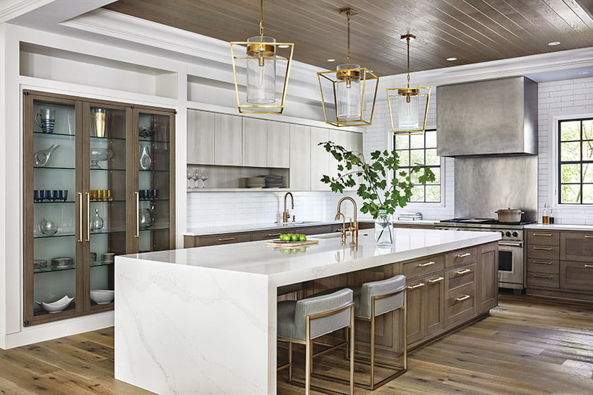 The open kitchen was reclaimed from ceiling to cabinetry in warm wood tones and characterized by clean lines and a transitional vibe.