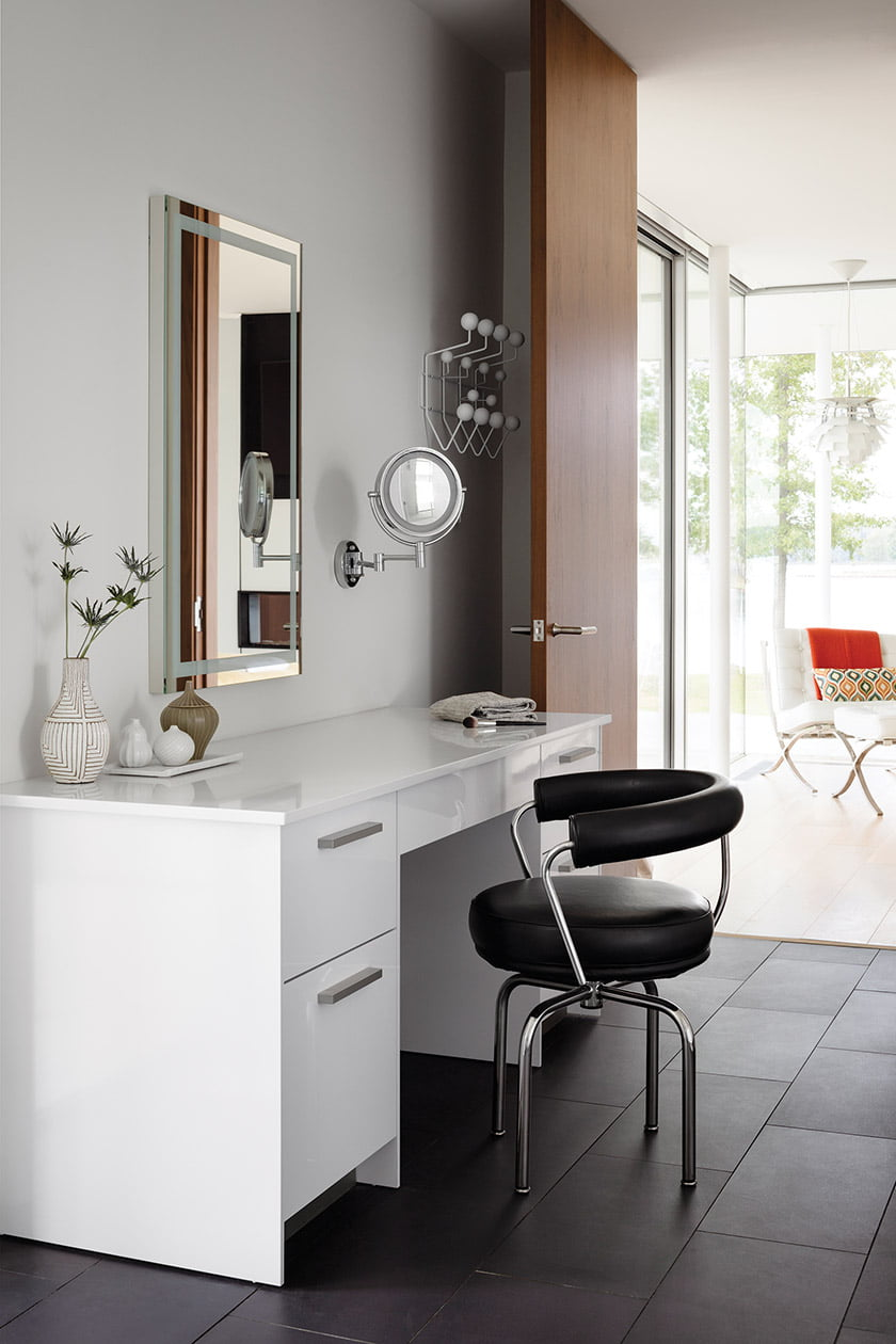 An LC7 swivel chair sits before a Snaidero vanity cabinet.