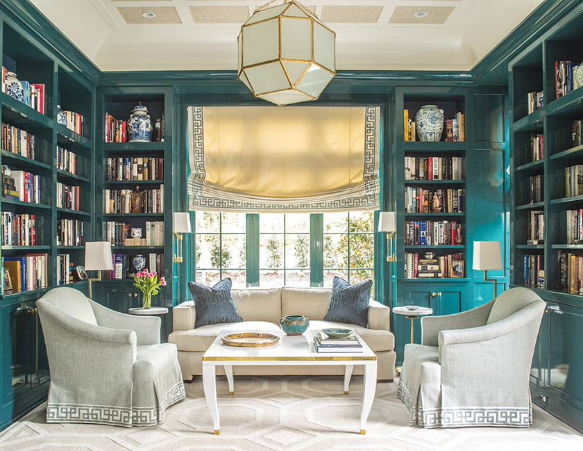 The library millwork in Benjamin Moore's glossy Mallard Green sets a glamorous stage.