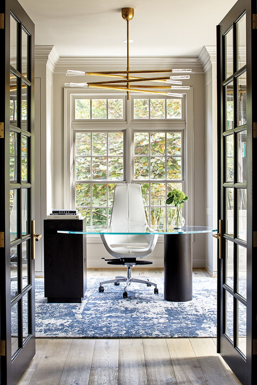 The office centers on a custom desk by Black Wolf Design.