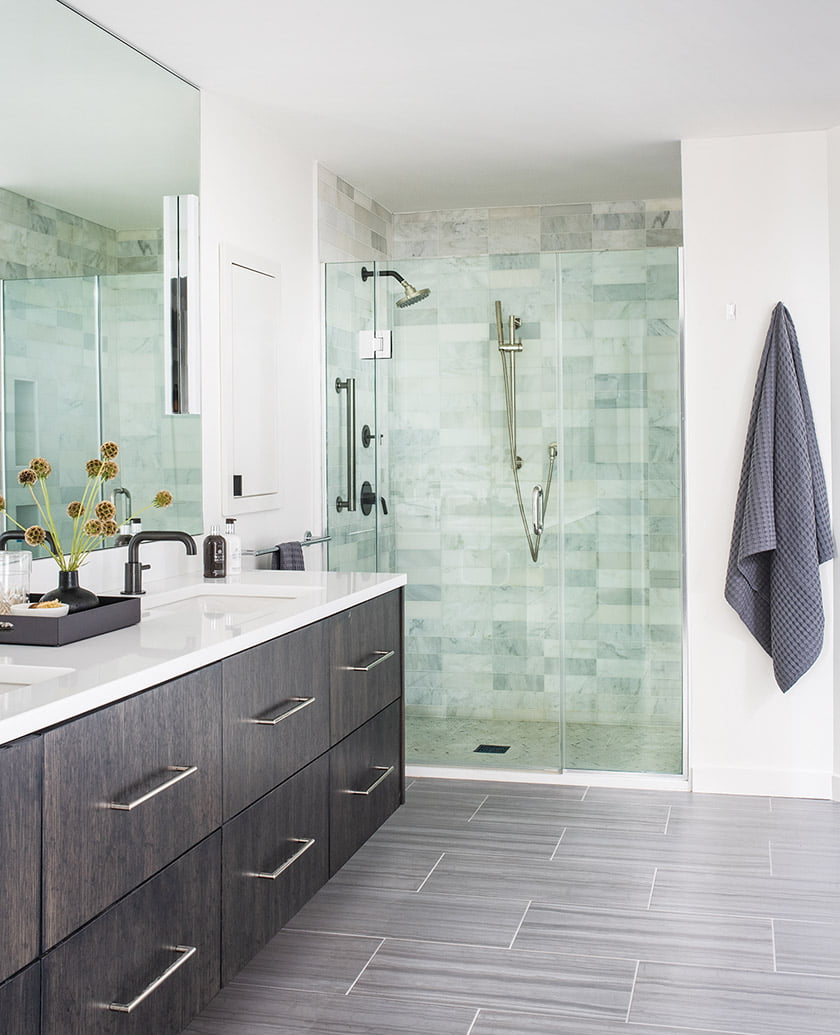 The owners' bath boasts a custom oak vanity and shower tile from Architessa.