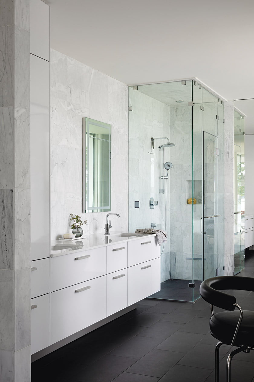 The owners' bath is outfitted with statuary marble wall tile from Best Tile and Grohe plumbing fixtures.