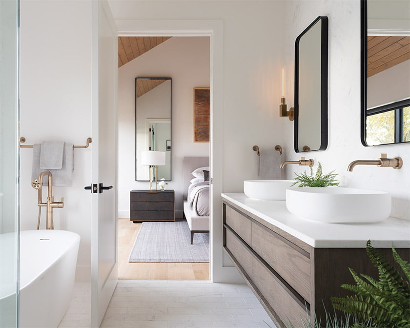 The furniture and bathroom vanity  in the owners' bath are from RH; the sinks are by Porcelanosa.