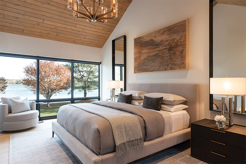 The owners' suite has its own magnificent vista; an abstract landscape by Savannah artist Mary Hartman hangs over the bed. Photo: Daniel Grehl