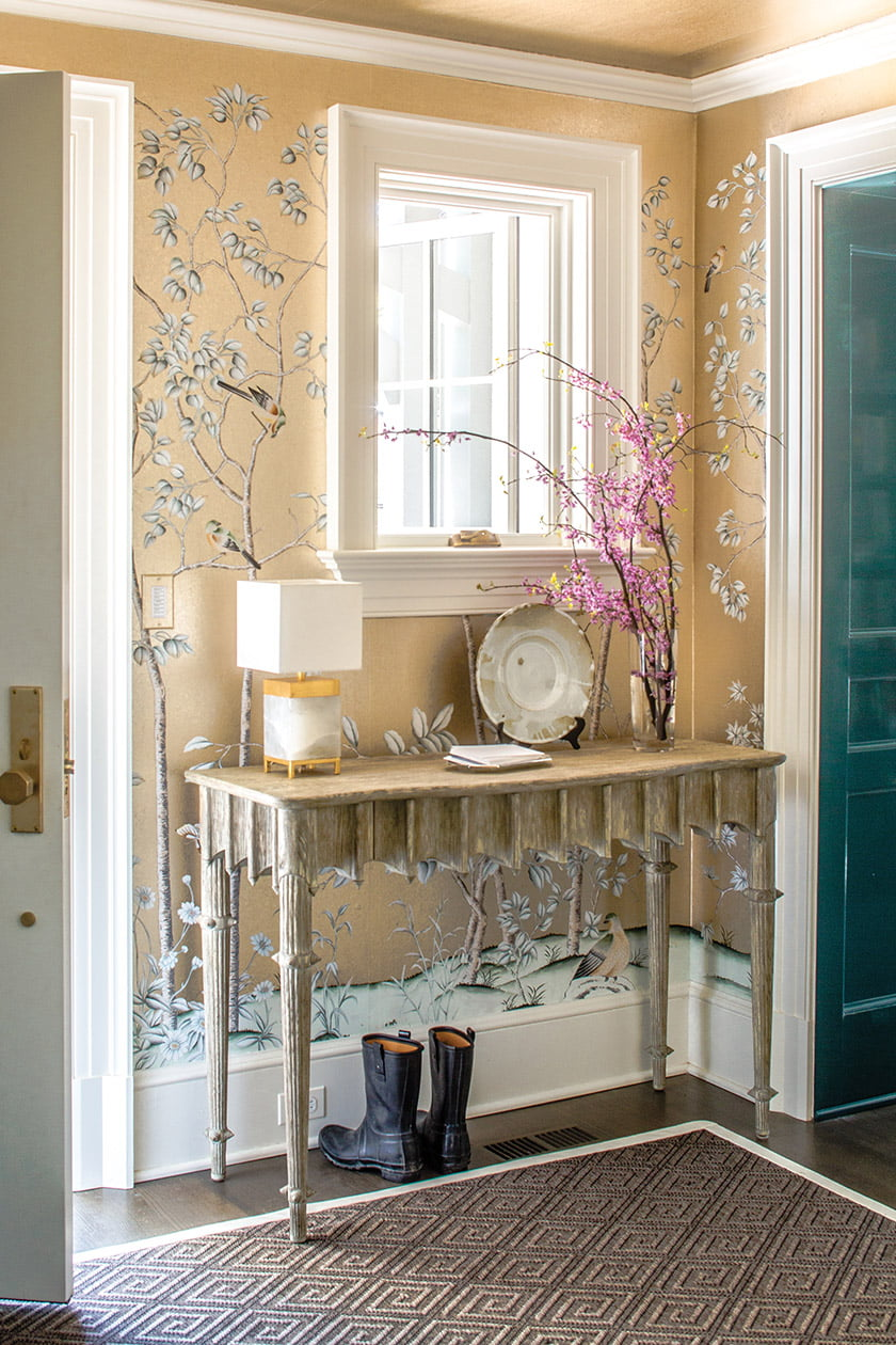 Wallpaper from Paul Montgomery Studio graces the foyer's walls and ceiling.