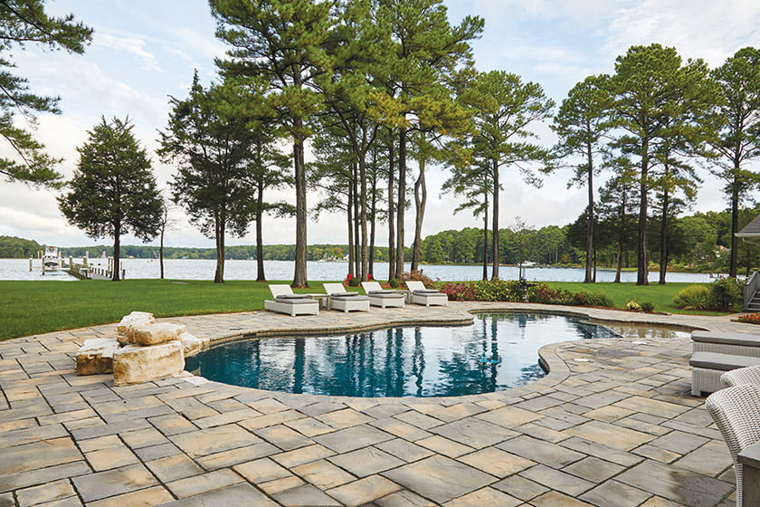 A pool, part of the property before the renovation, enjoys scenic views of Grace Creek and the owners' boat dock.