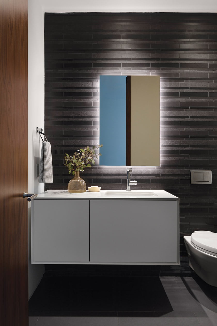 The powder room features Daltile's Unity porcelain tile in Nero and a Grohe faucet.