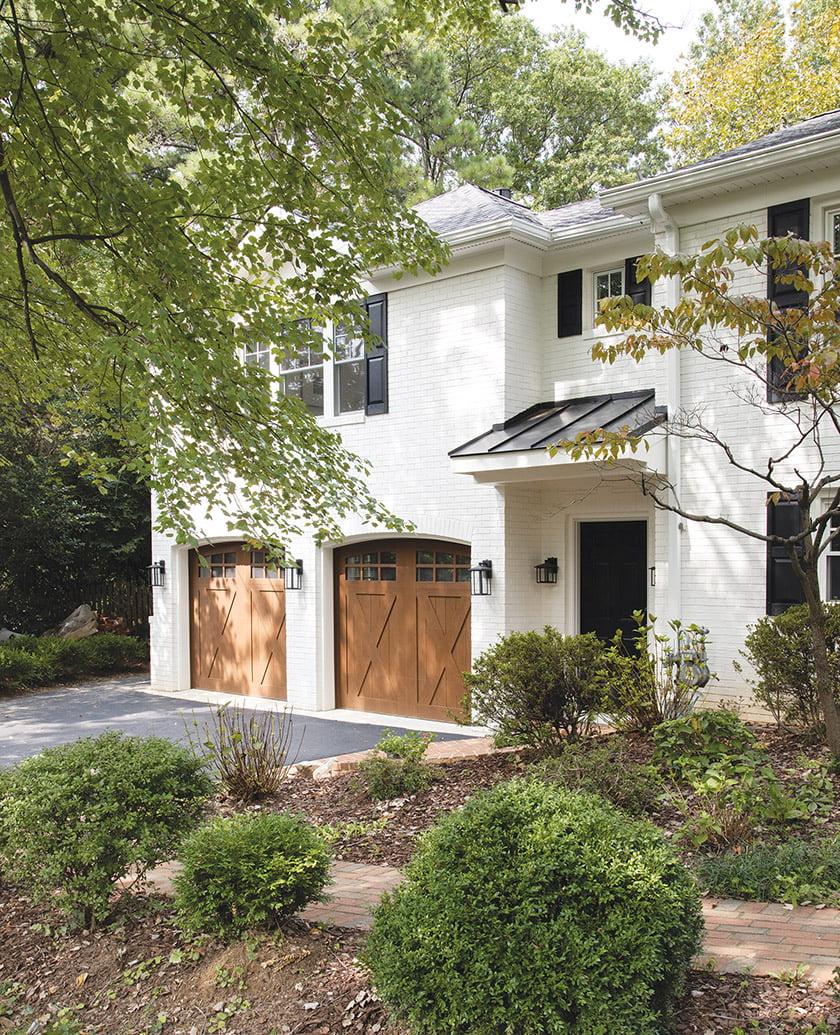 Mahogany garage doors enhance the home's curb appeal.