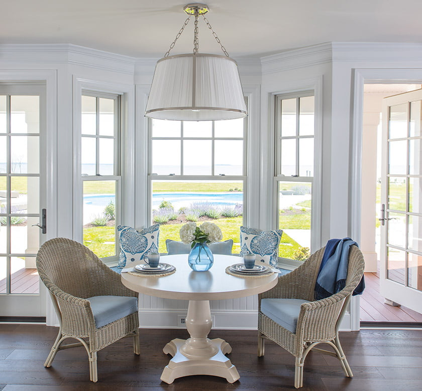 Casual meals take place around a Tritter Feefer table with a built-in window seat offering prime views.
