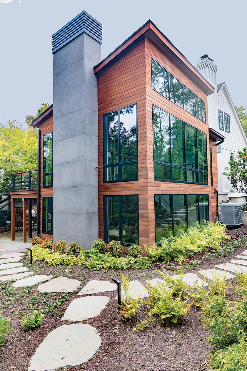 The design team added modern curb appeal to the front of the house with expansive Kolbe windows.