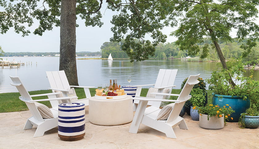 Clean-lined Adirondack chairs from Design Within Reach and Made Goods ceramic stools provide a laid-back perch for taking in river views.