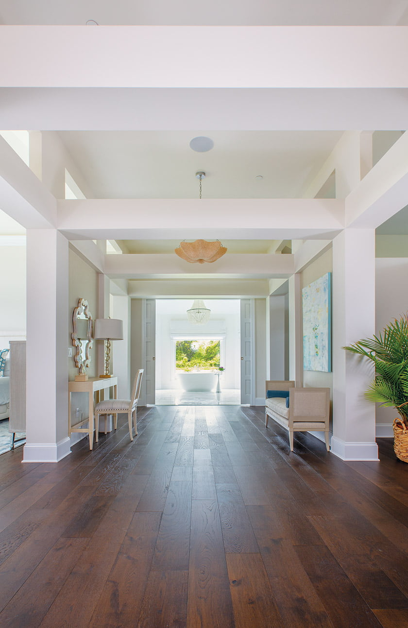 A wide, airy corridor runs like a spine through the owners' wing, culminating in the elegant, marble-clad owners' bath.