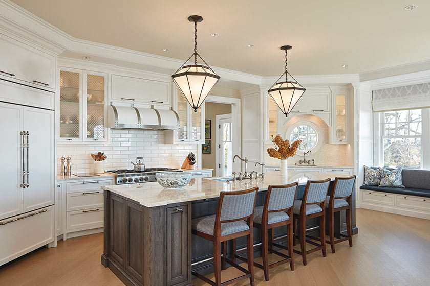 The revamped kitchen boasts a beverage bar and a built-in banquette.