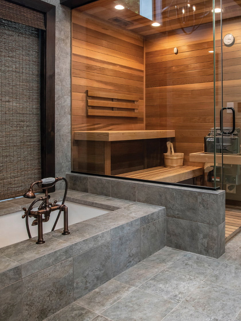 A sleek spa bath of stone and wood is both functional and luxurious, a relaxing retreat at home complete with a sauna.